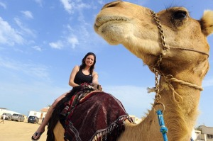 Random well-travelled woman on a camel